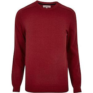 Pull rouge vif avec coutures apparentes aux épaules