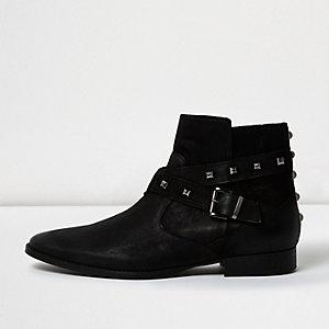 Schwarze Lederstiefel mit Mieten und Schnalle