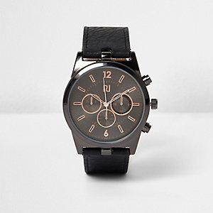 Montre noire à bracelet texturé