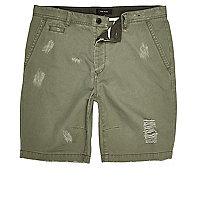 Green ripped skater shorts