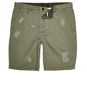Green ripped skater shorts