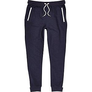 Pantalon de jogging bleu marine à rayures sur le côté