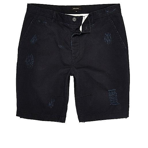 Navy ripped skater shorts