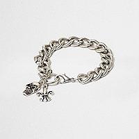 Bracelet à maillons argenté avec breloques tête de mort