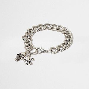 Silver tone skull chain bracelet