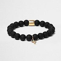 Black bauble cross bracelet