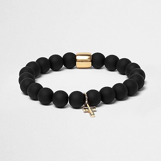 Bracelet noir à breloque croix