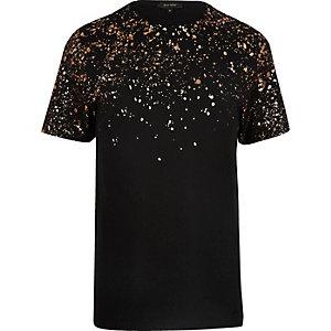 T-shirt noir avec imprimé éclaboussures sur l'épaule