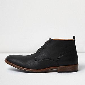 Black perforated chukka boots