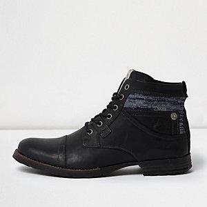 Schwarze Lederstiefel mit Textilmanschette