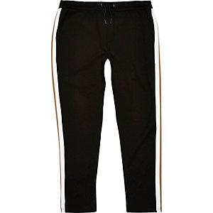 Pantalon de jogging noir à rayure sur le côté