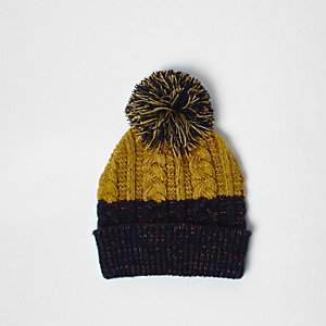 Navy and mustard twist knit bobble hat