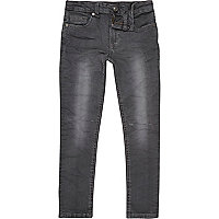 Boys blue dark wash rip knee slim jeans