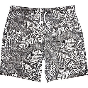 Boys black tropical leaf print swim shorts