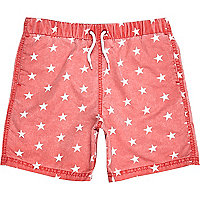 Boys red star print swim shorts