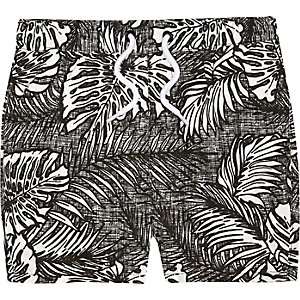Mini boys black tropical print swim trunks