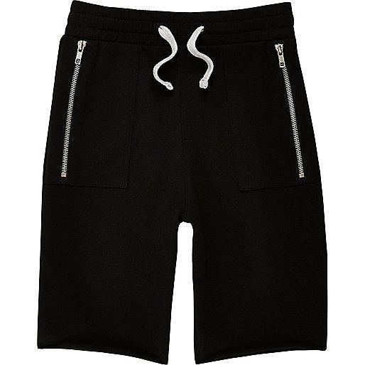 Boys black drop crotch shorts