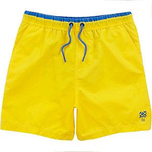 Boys yellow swim trunks
