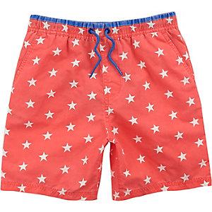Boys orange star print swim trunks