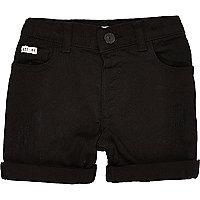 Schwarze Skinny Jeans-Shorts