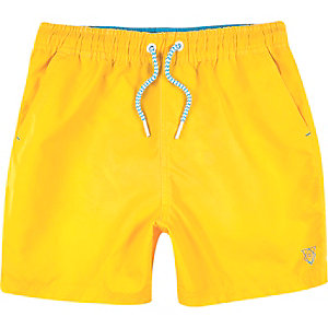 Boys bright yellow swim trunks