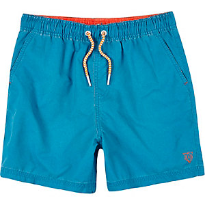Boys bright blue swim trunks