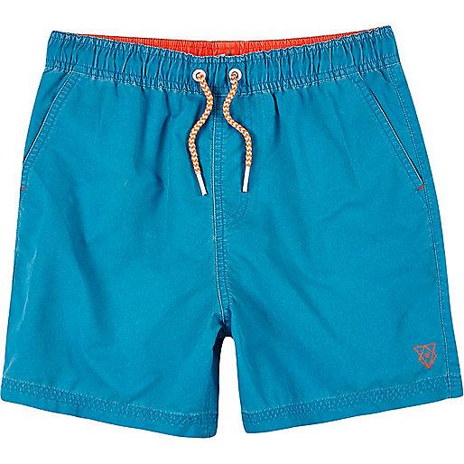 Boys bright blue swim trunks