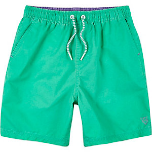 Boys bright green swim trunks