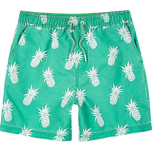 Boys bright green pineapple print swim shorts