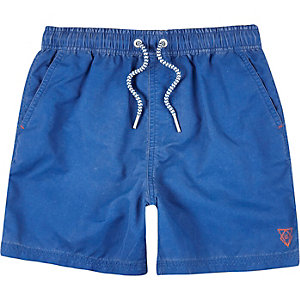 Boys blue swim trunks