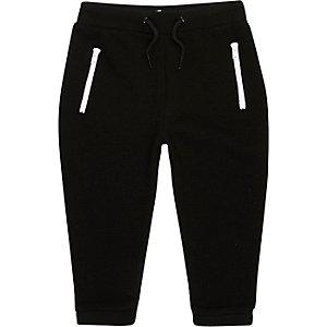 Pantalon de survêtement noir zippé mini garçon