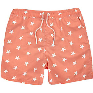 Boys orange star print shorts