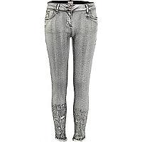 Grey distressed hem super skinny jeans