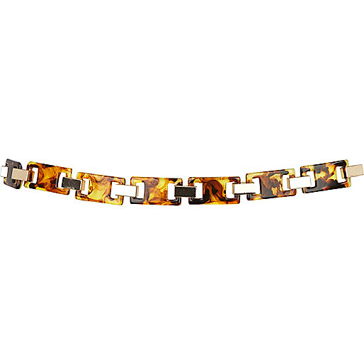 Brown print tort link belt