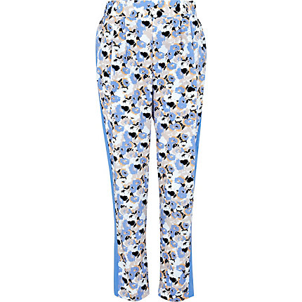 Blue floral printed tapered trousers