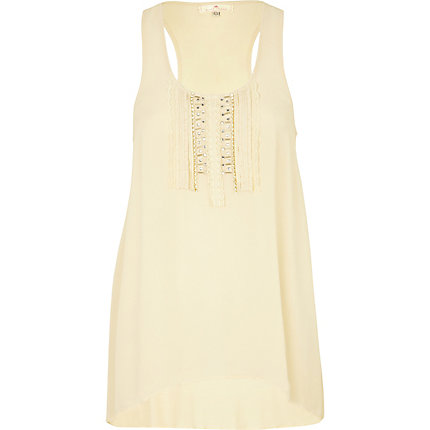 Cream sleeveless tunic top