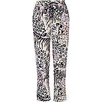 Purple leopard print trousers