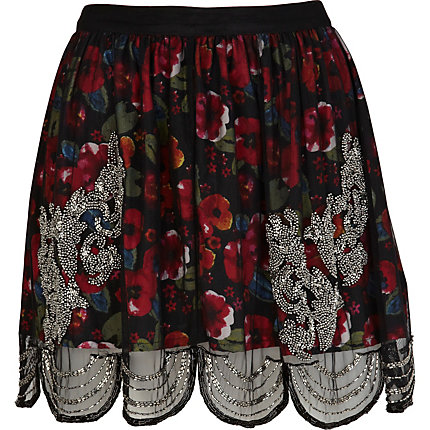 Red floral print sequin overlay mini skirt