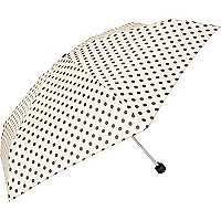 Cream polka dot umbrella