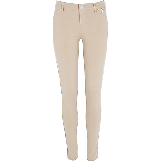 Light beige skinny trousers