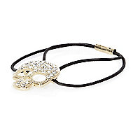 Gold tone diamante skull hair band