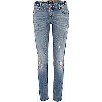 Light wash distressed Matilda skinny jeans