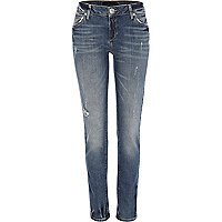 Mid wash distressed Taylor skinny jeans