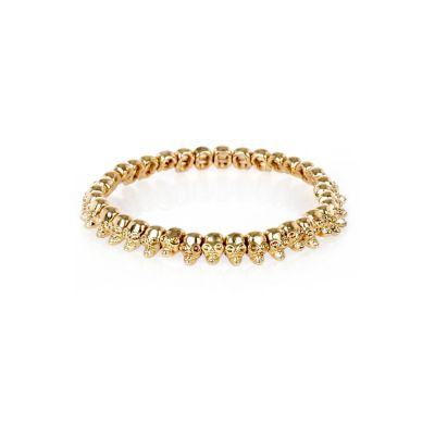 Gold tone skull stretch bracelet