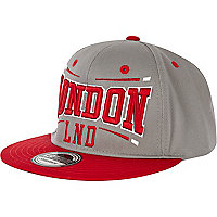 Grey and red London print trucker hat