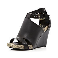 Black open toe caged snake wedges