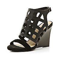 Black cut out caged wedge sandals