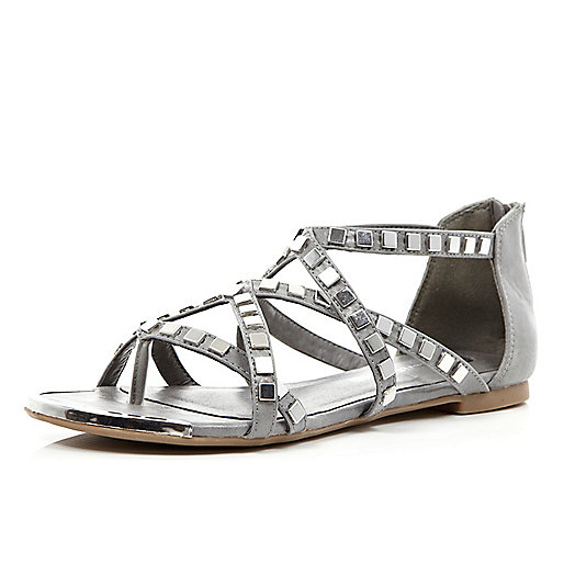 Grey studded metal gladiator sandals