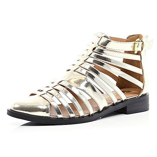 Gold closed toe gladiator sandals
