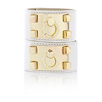 White leather hand cuff set